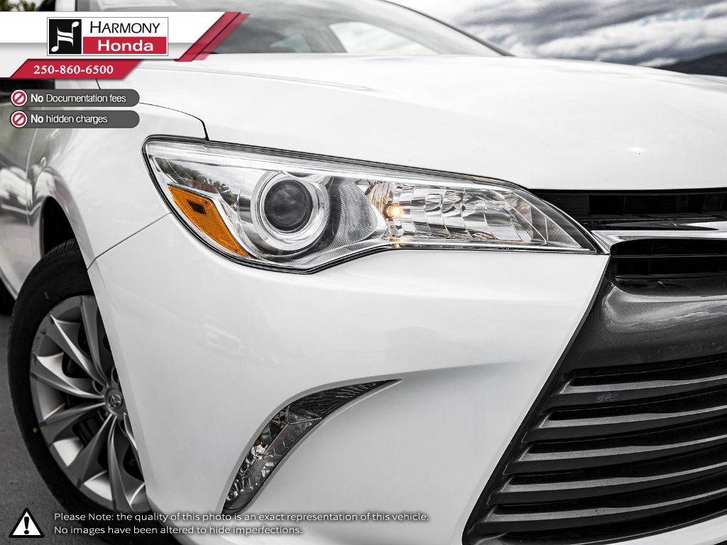 White 2016 Toyota Camry Right Rear Corner Photo in Kelowna BC