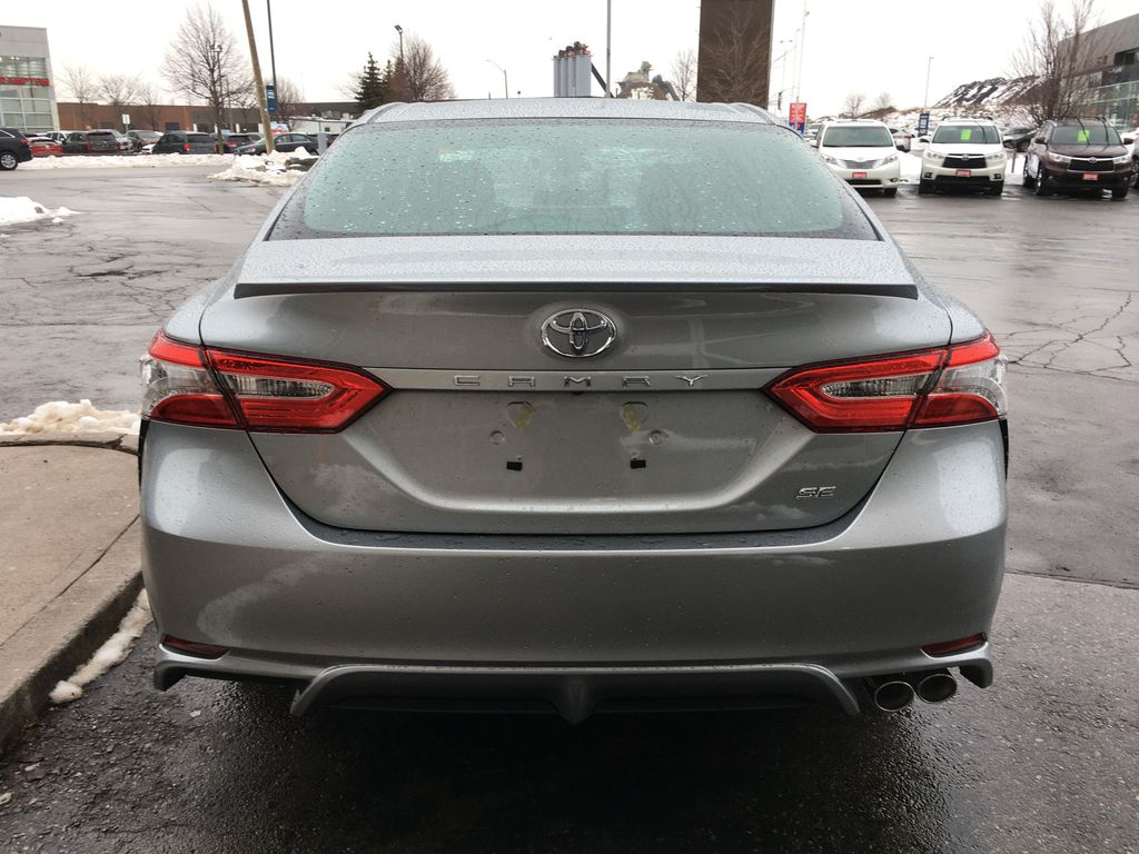 Silver[Celestial Silver Metallic] 2020 Toyota Camry SE Standard Package B11HST AM Rear of Vehicle Photo in Brampton ON
