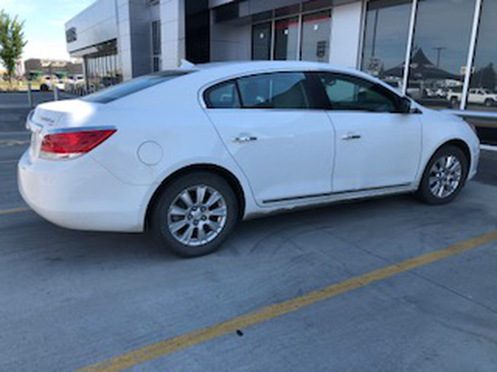 White 2010 Buick LaCrosse Left Front Rim and Tire Photo in Lethbridge AB
