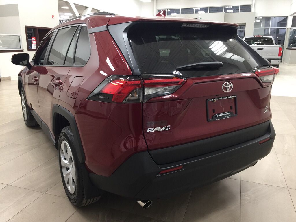 Red[Ruby Flare Pearl] 2020 Toyota RAV4 LE AWD Left Rear Corner Photo in Sherwood Park AB