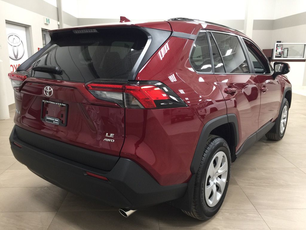 Red[Ruby Flare Pearl] 2020 Toyota RAV4 LE AWD Right Rear Corner Photo in Sherwood Park AB