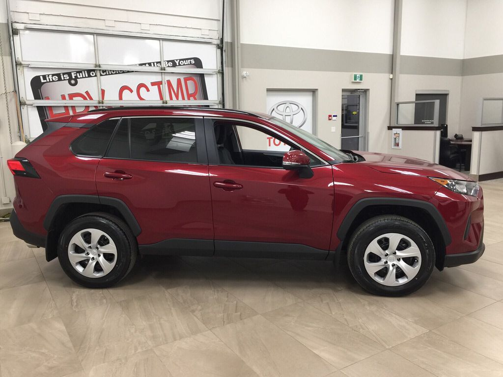 Red[Ruby Flare Pearl] 2020 Toyota RAV4 LE AWD Right Side Photo in Sherwood Park AB