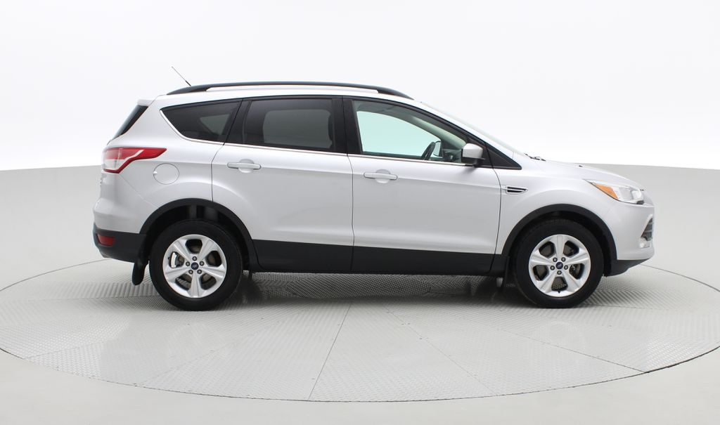 Silver[Ingot Silver Metallic] 2014 Ford Escape SE AWD - Panoramic Roof, MyFord Touch, SAT Radio Right Side Photo in Winnipeg MB