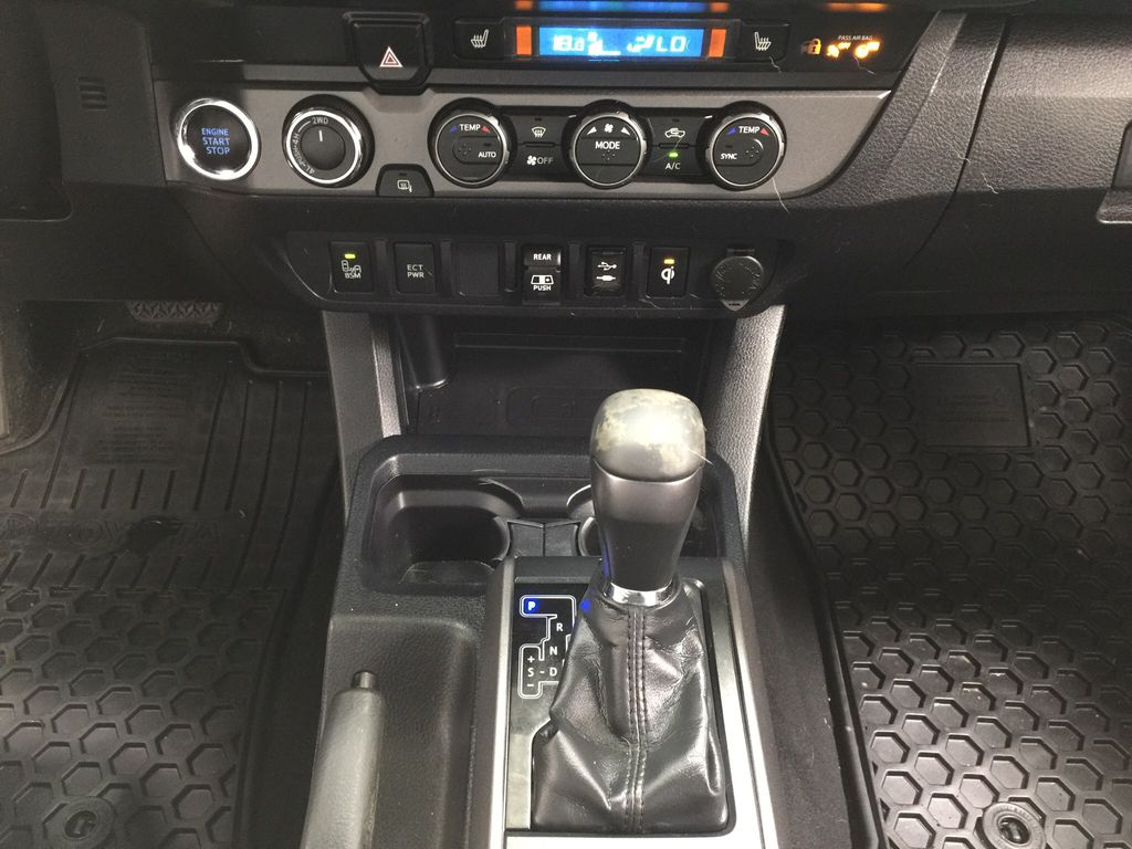 Black[Midnight Black Metallic] 2019 Toyota Tacoma TRD Sport Premium Upgrade Lower Dash Photo in Sherwood Park AB