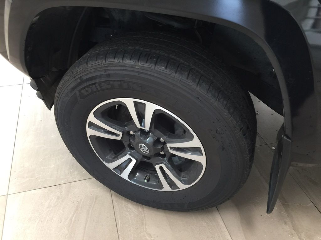 Black[Midnight Black Metallic] 2019 Toyota Tacoma TRD Sport Premium Upgrade Left Front Rim and Tire Photo in Sherwood Park AB
