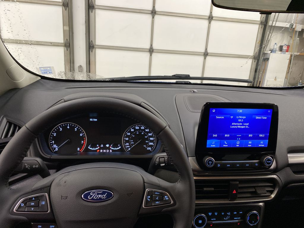 Blue[Blue Candy Metallic Tinted Clearcoat] 2020 Ford EcoSport Steering Wheel and Dash Photo in Dartmouth NS