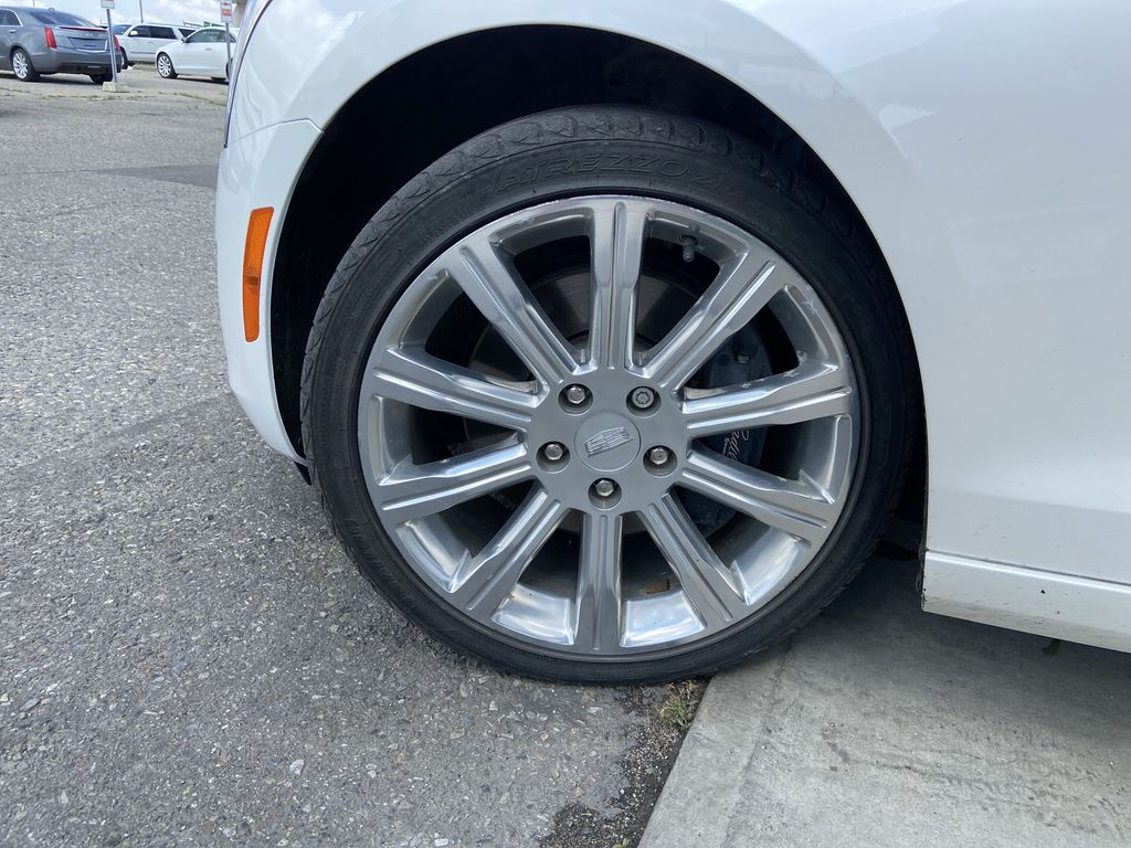 White[Crystal White Tricoat] 2017 Cadillac ATS Sedan Luxury Left Front Rim and Tire Photo in Calgary AB