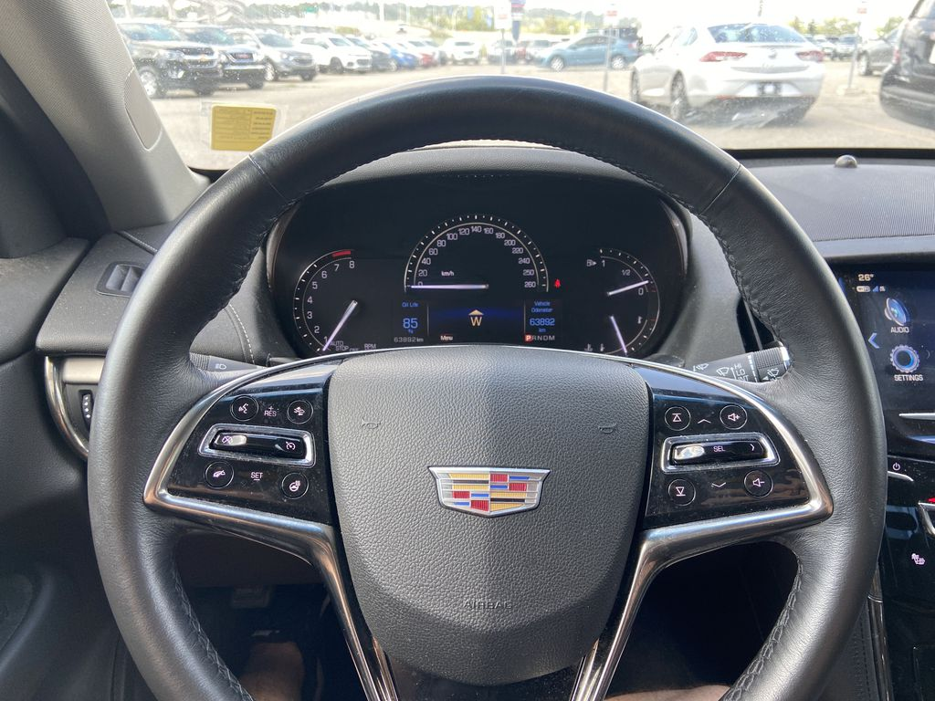 White[Crystal White Tricoat] 2017 Cadillac ATS Sedan Luxury Steering Wheel and Dash Photo in Calgary AB