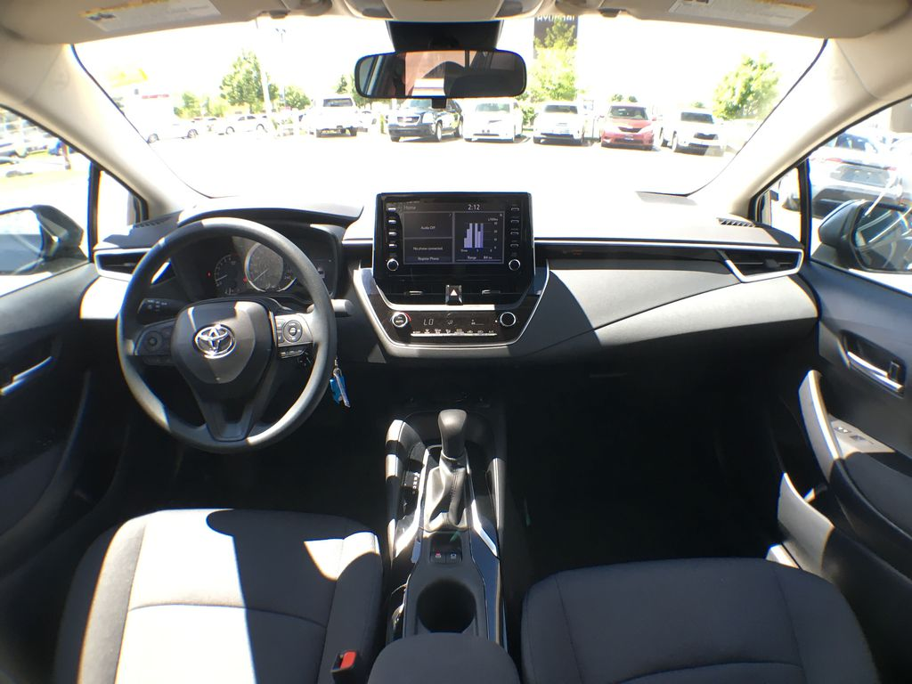 Black[Black Sand Pearl] 2020 Toyota Corolla LE Standard Package BPRBLC AM Strng Wheel/Dash Photo: Frm Rear in Brampton ON