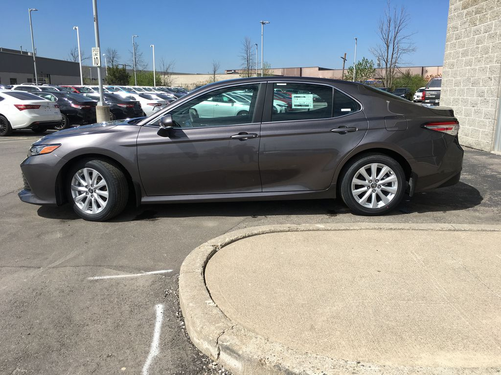 Gray[Pre-Dawn Grey Mica] 2020 Toyota Camry LE Standard Package B11HLT AM Left Side Photo in Brampton ON