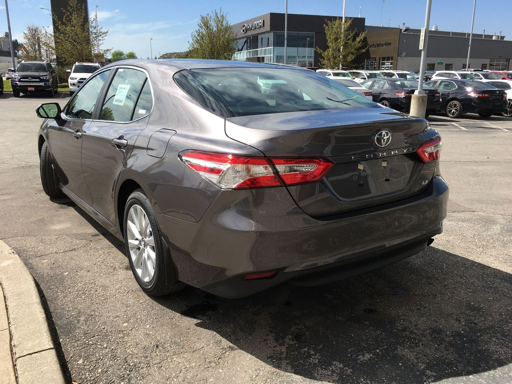 Gray[Pre-Dawn Grey Mica] 2020 Toyota Camry LE Standard Package B11HLT AM Left Rear Corner Photo in Brampton ON