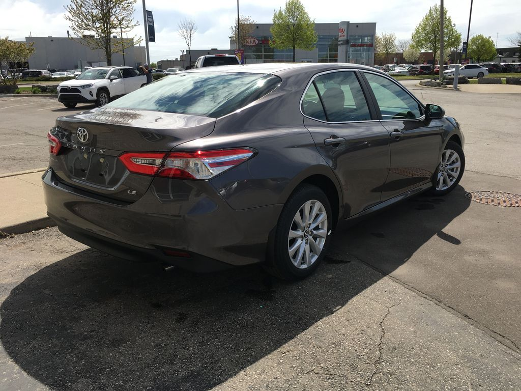 Gray[Pre-Dawn Grey Mica] 2020 Toyota Camry LE Standard Package B11HLT AM Right Rear Corner Photo in Brampton ON