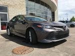 Gray[Pre-Dawn Grey Mica] 2020 Toyota Camry LE Standard Package B11HLT AM Right Front Corner Photo in Brampton ON