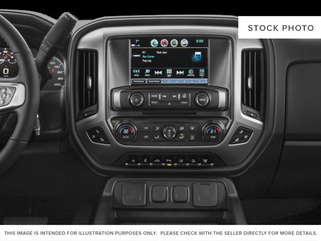 White[Summit White] 2018 GMC Sierra 2500HD Radio Controls Closeup Photo in Fort Macleod AB