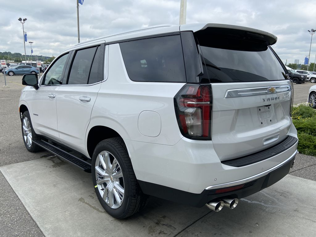 White[Iridescent Pearl Tricoat] 2021 Chevrolet Tahoe High Country Left Rear Corner Photo in Calgary AB