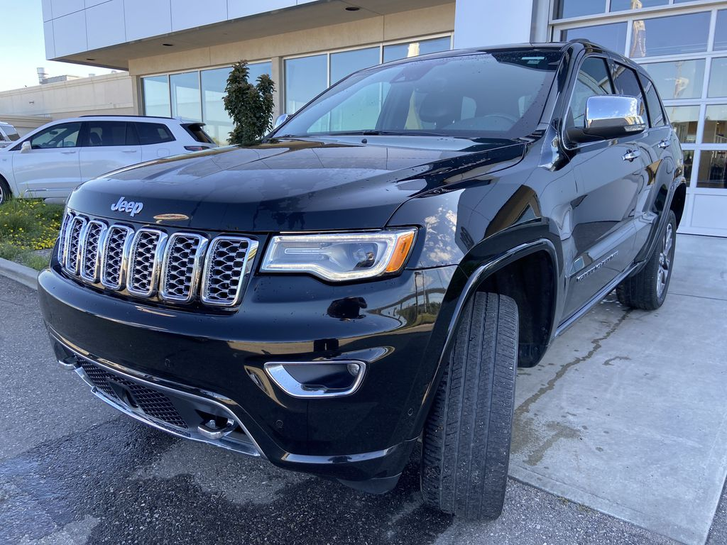Black[Diamond Black Crystal Pearl] 2017 Jeep Grand Cherokee Overland Left Front Head Light / Bumper and Grill in Calgary AB