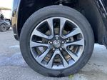 Black[Diamond Black Crystal Pearl] 2017 Jeep Grand Cherokee Overland Left Front Rim and Tire Photo in Calgary AB