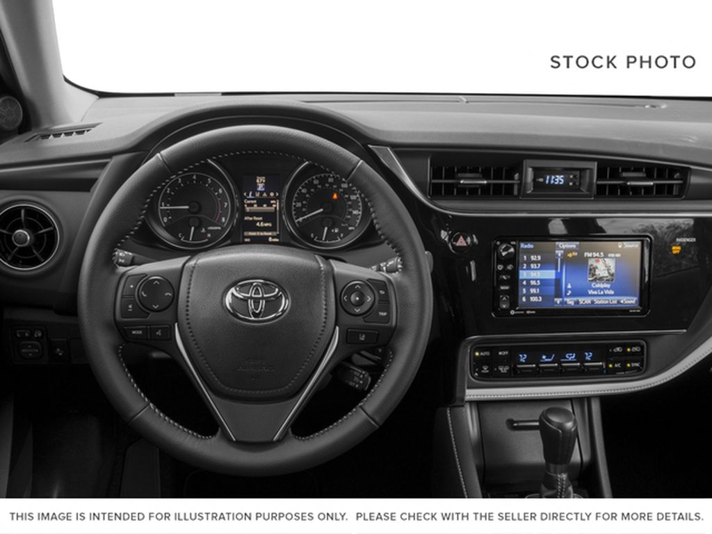 White[Blizzard Pearl] 2018 Toyota Corolla iM Steering Wheel and Dash Photo in Kelowna BC