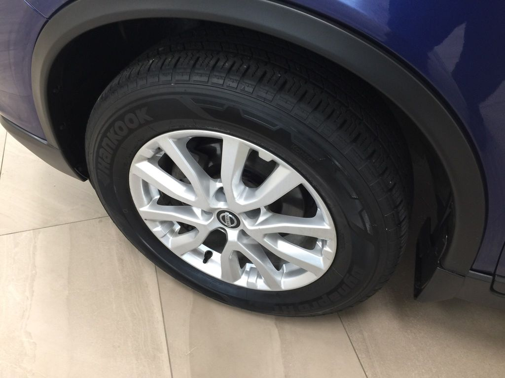 Blue[Caspian Blue Metallic] 2017 Nissan Rogue SV AWD Left Front Rim and Tire Photo in Sherwood Park AB