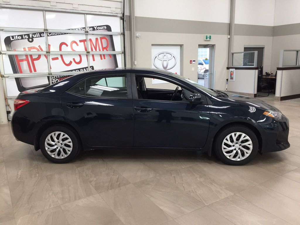 Blue[Galactic Aqua Mica] 2017 Toyota Corolla LE Right Side Photo in Sherwood Park AB