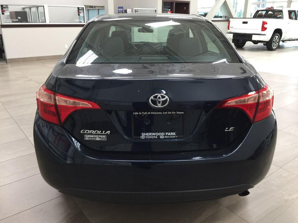 Blue[Galactic Aqua Mica] 2017 Toyota Corolla LE Rear of Vehicle Photo in Sherwood Park AB