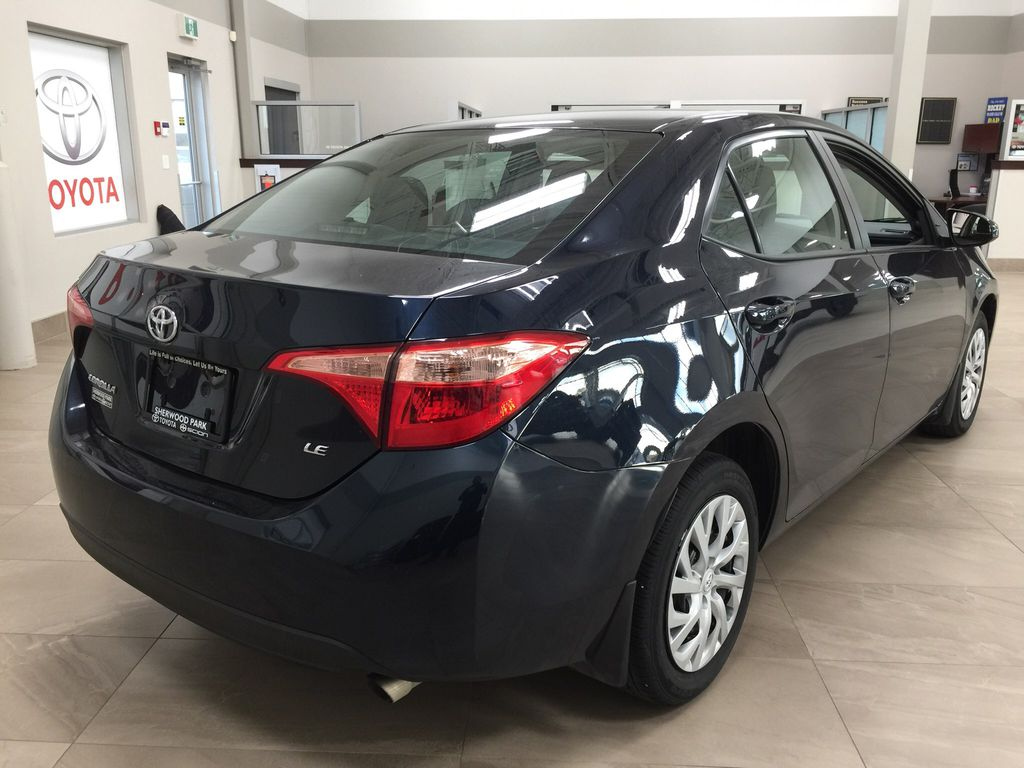 Blue[Galactic Aqua Mica] 2017 Toyota Corolla LE Right Rear Corner Photo in Sherwood Park AB