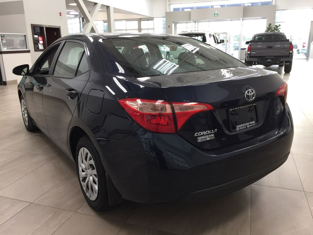 Blue[Galactic Aqua Mica] 2017 Toyota Corolla LE Left Rear Corner Photo in Sherwood Park AB