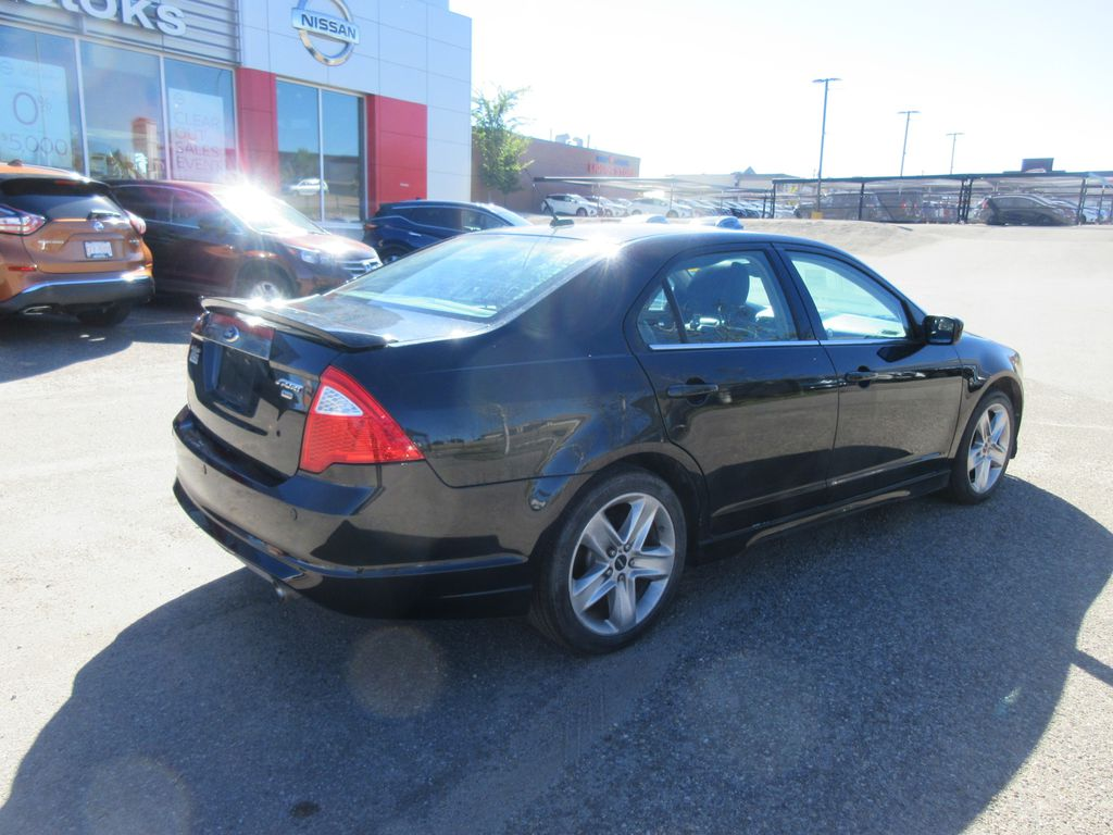 Black[Black] 2012 Ford Fusion Steering Wheel and Dash Photo in Okotoks AB