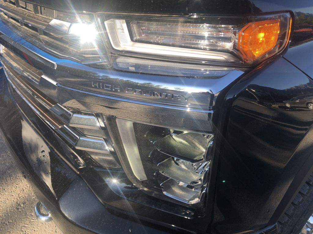 Black[Black] 2020 Chevrolet Silverado 2500HD Left Front Head Light / Bumper and Grill in Canmore AB