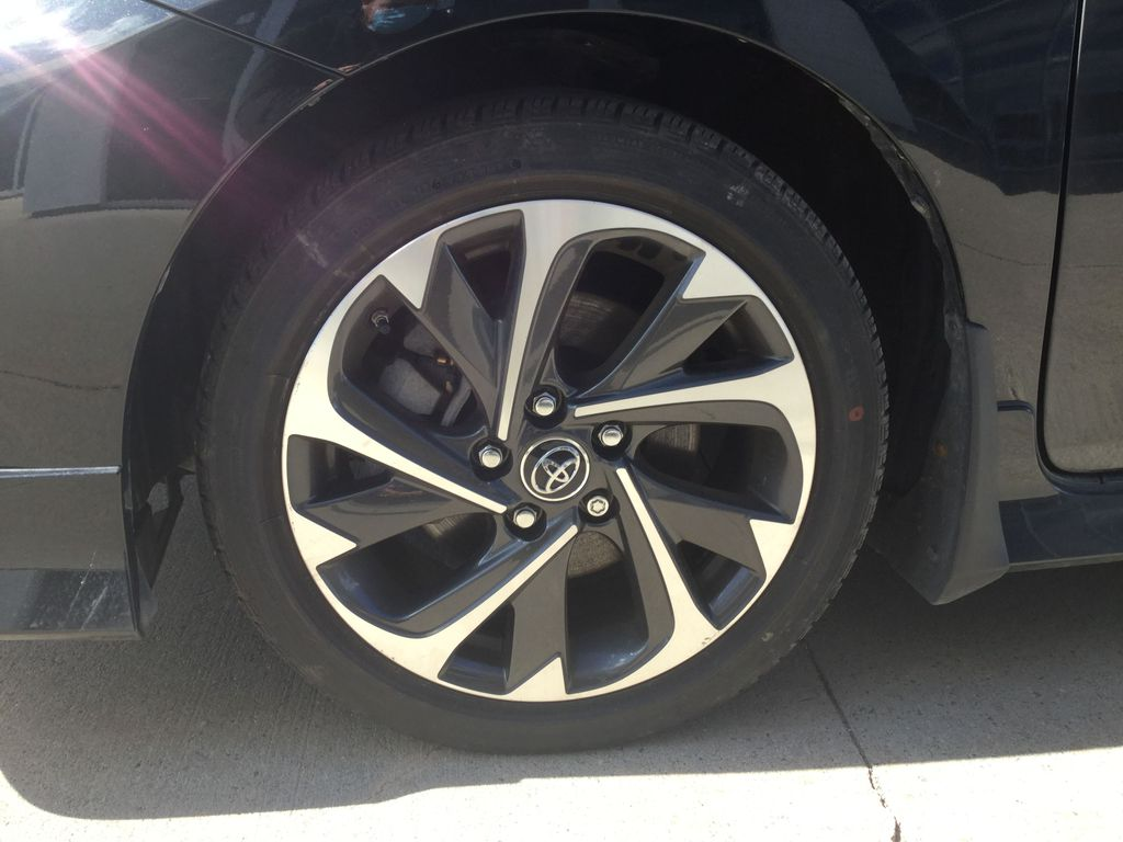 Black[Black Sand Pearl] 2018 Toyota Corolla iM Left Front Rim and Tire Photo in Brockville ON