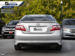 Silver - Classic Silver Metallic 2009 Toyota Camry Left Side Photo in Kelowna BC