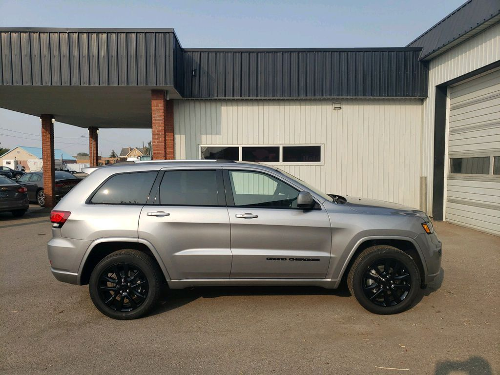 Silver 2020 Jeep Grand Cherokee Left Front Interior Photo in Fort Macleod AB