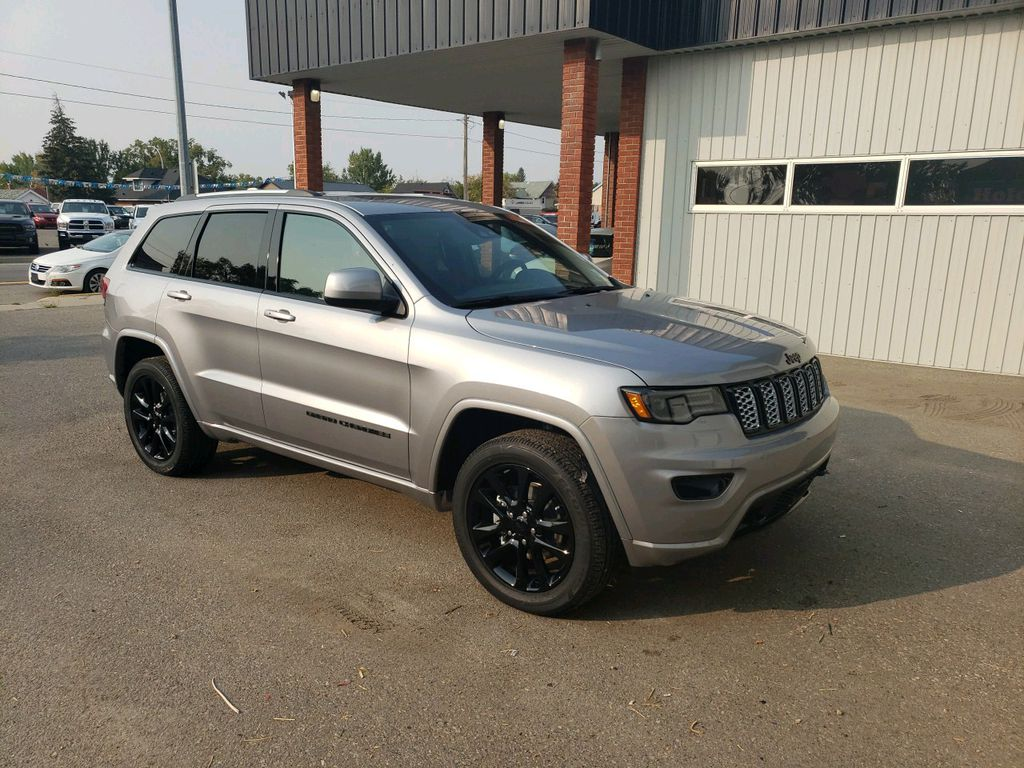 Silver 2020 Jeep Grand Cherokee Left Front Rim and Tire Photo in Fort Macleod AB