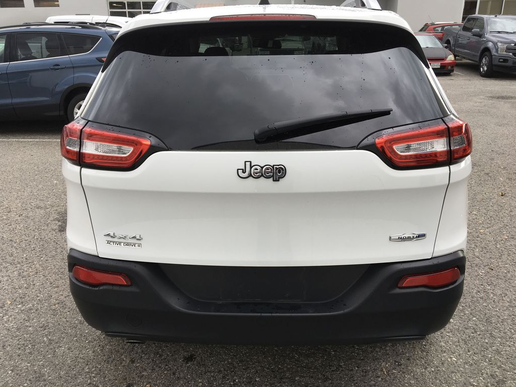 White[Bright White] 2016 Jeep Cherokee North Edition Rear of Vehicle Photo in Kelowna BC