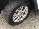 White[Bright White] 2016 Jeep Cherokee North Edition Left Front Rim and Tire Photo in Kelowna BC