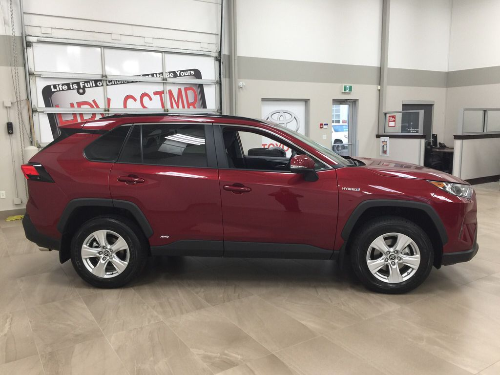 Red[Ruby Flare Pearl] 2020 Toyota RAV4 XLE Hybrid Right Side Photo in Sherwood Park AB