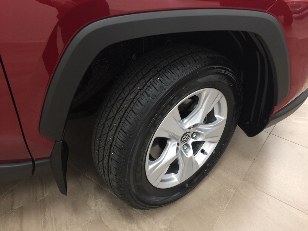 Red[Ruby Flare Pearl] 2020 Toyota RAV4 XLE Hybrid Right Front Rim and Tire Photo in Sherwood Park AB