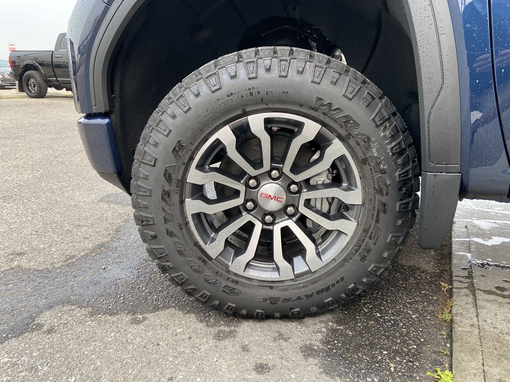 Blue[Pacific Blue Metallic] 2020 GMC Sierra 1500 AT4 Left Front Rim and Tire Photo in Calgary AB