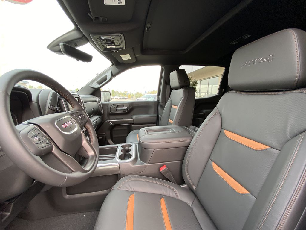Blue[Pacific Blue Metallic] 2020 GMC Sierra 1500 AT4 Left Front Interior Photo in Calgary AB