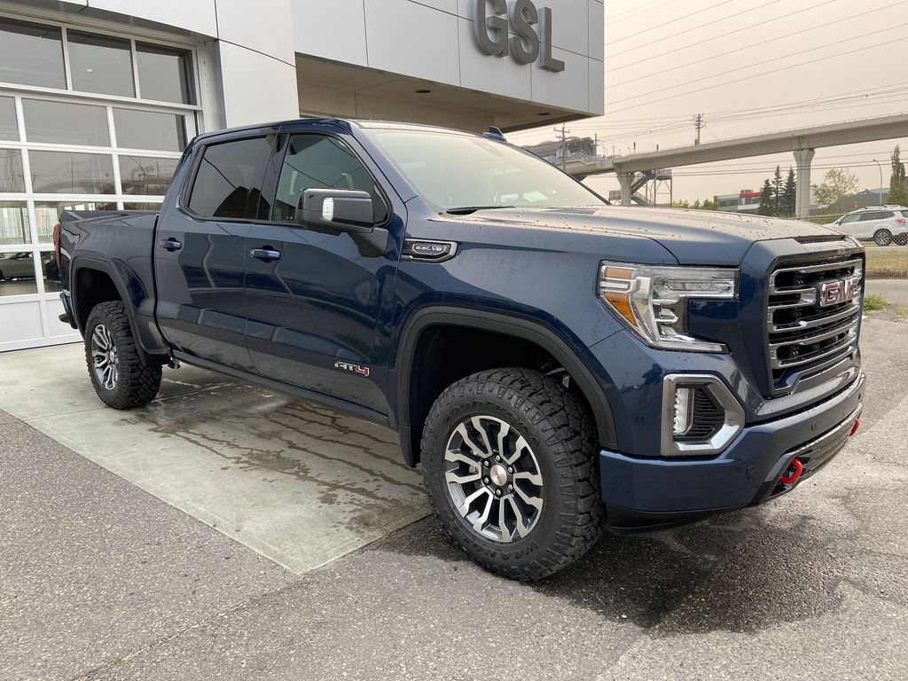 Blue[Pacific Blue Metallic] 2020 GMC Sierra 1500 AT4 Right Front Corner Photo in Calgary AB