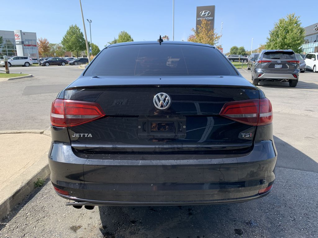 Black[Deep Black Pearl] 2017 Volkswagen Jetta Sedan Left Front Interior Photo in Brampton ON