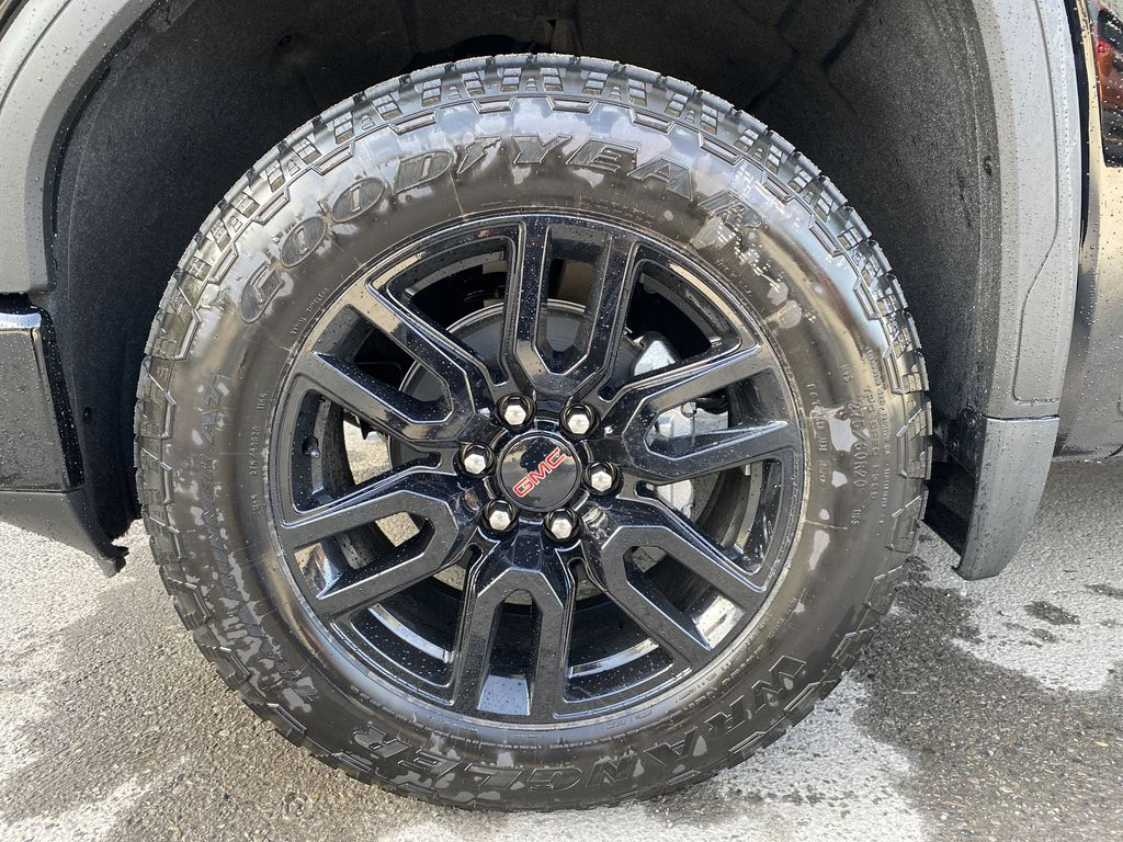 Black[Carbon Black Metallic] 2020 GMC Sierra 1500 Elevation Left Front Rim and Tire Photo in Canmore AB