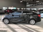 Black 2013 Kia Rio LX+ Left Side Photo in Edmonton AB