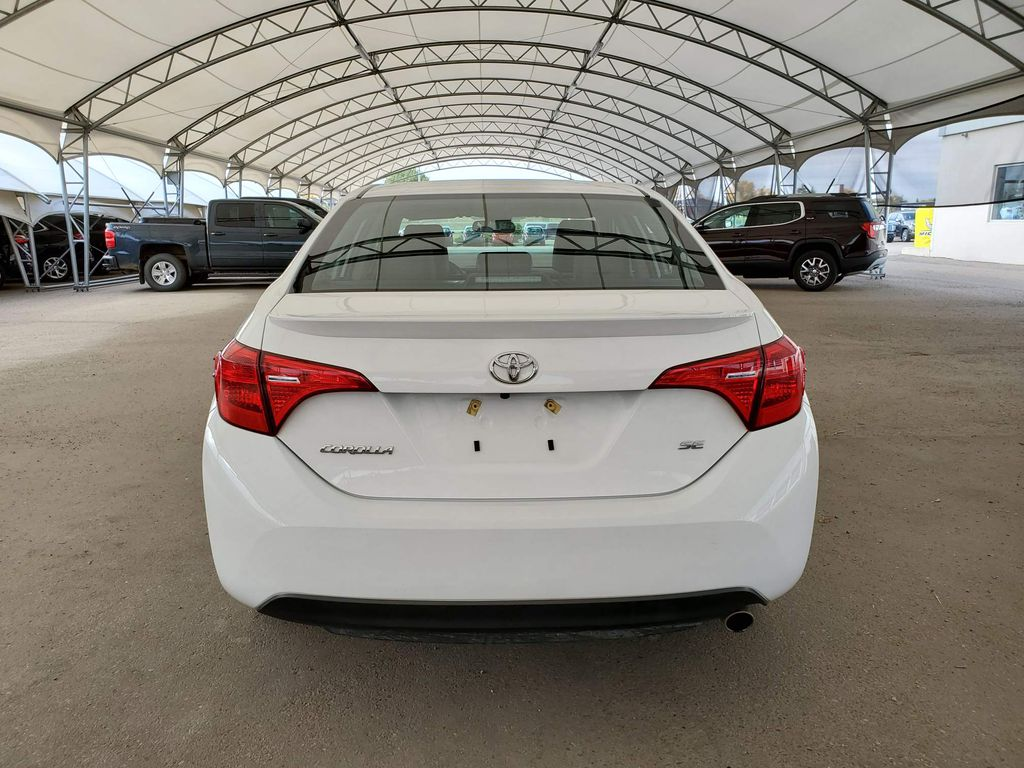 White 2019 Toyota Corolla Central Dash Options Photo in Airdrie AB