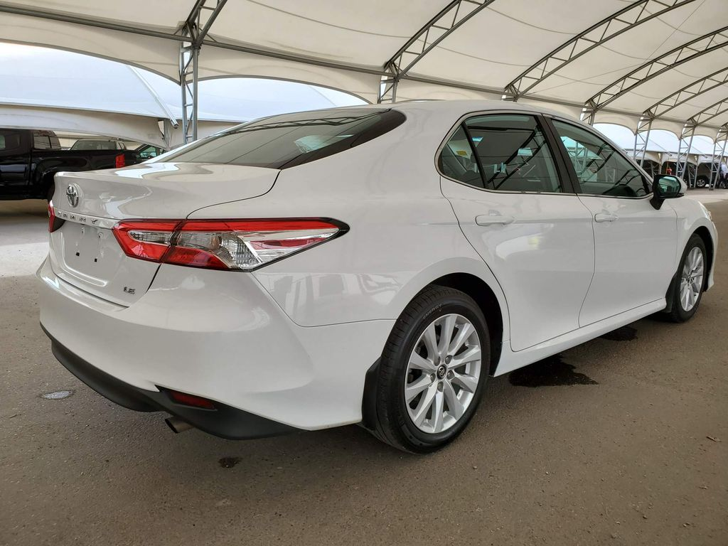 White 2019 Toyota Camry Strng Wheel/Dash Photo: Frm Rear in Airdrie AB