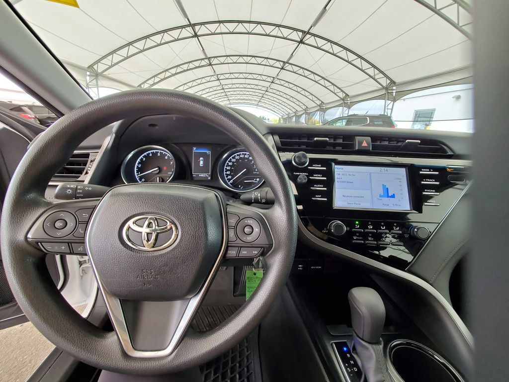 White 2019 Toyota Camry Left Side Photo in Airdrie AB