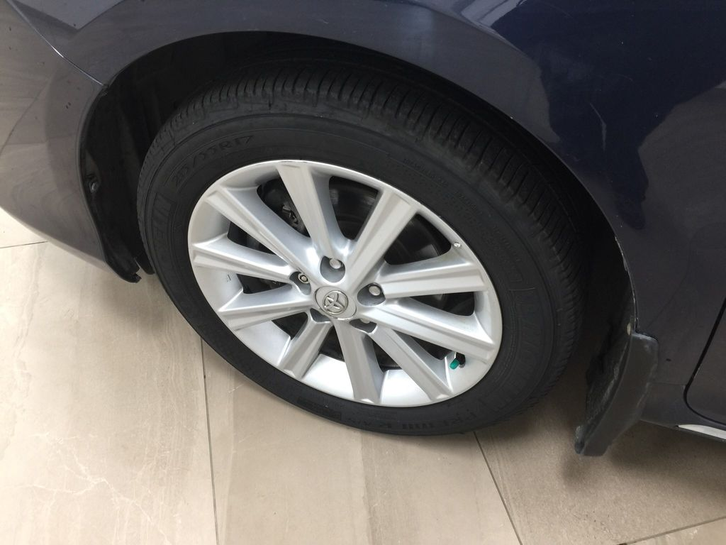 Blue[Parisian Night Pearl] 2014 Toyota Camry Hybrid XLE Left Front Rim and Tire Photo in Sherwood Park AB