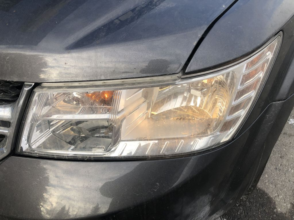 Gray[Granite Crystal Metallic] 2015 Dodge Journey R/T Left Front Head Light / Bumper and Grill in Canmore AB
