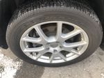 Gray[Granite Crystal Metallic] 2015 Dodge Journey R/T Left Front Rim and Tire Photo in Canmore AB