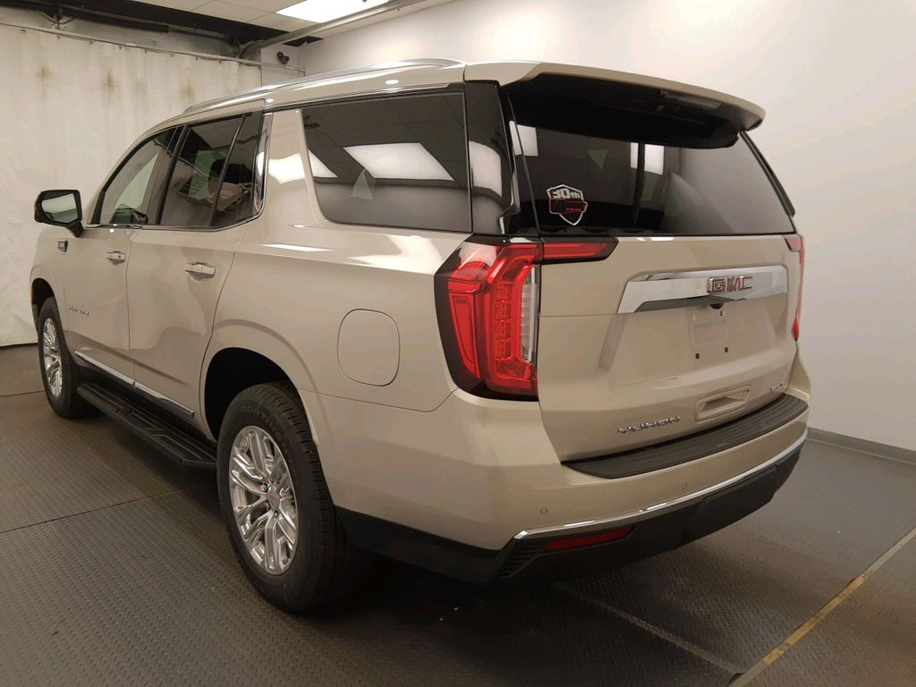 Beige 2021 GMC Yukon Left Front Head Light / Bumper and Grill in Lethbridge AB